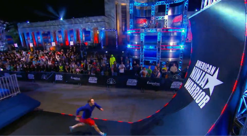 An American Ninja Warrior Contestant Attempts The Warped Wall Photo Credit